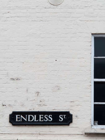 architectural exteriors: Endless Street sign mounted on painted brick wall Editorial