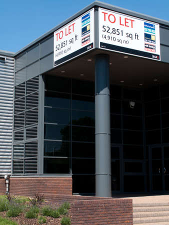 Estate agents industrial warehouse and office units to let sign Editorial
