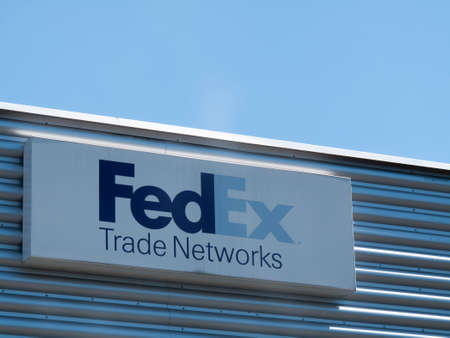 middlesex: FedEx Corporation sign mounted on side of building, American courier delivery service company