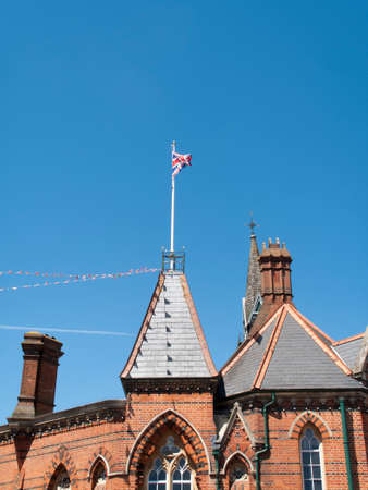 Wokingham, Market Place, Berkshire, England - June 3, 2017: Wokingham Borough Council old Victorian town hall building, construction completed in 1860