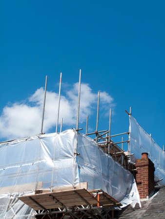 Rooftop contractors scaffolding over building development