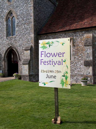 inform information: Saint Peter parish church in the Church of England diocese of Winchester, sign advertising local flower festival