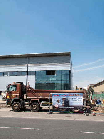 middlesex: A and H construction site sign, new commercial warehouse and office development