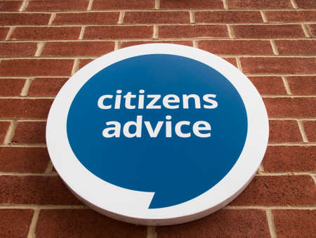 unbiased: Citizens advice sign mounted on brick wall, free charitable impartial consumer advice service, Editorial