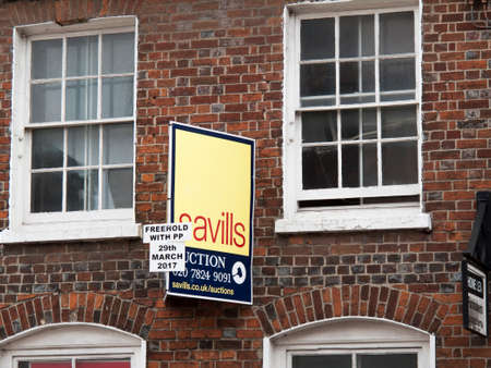 company premises: Estate Agent freehold auction sign for vacant office space