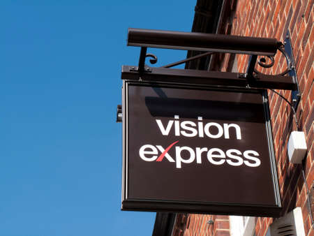 Vision Express optician sign over premise, British company established in 1988 Editorial