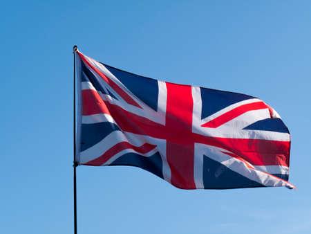 United Kingdom Union Jack Flag against a clear blue sky