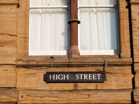 transom: High Street place name on historic stone building