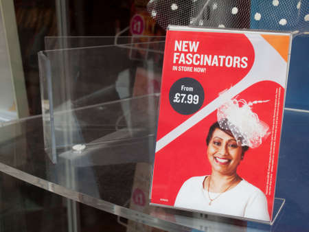 New fascinators in store now sign in retail shop window
