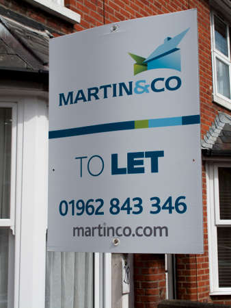 Martin and Co Estate agent sign advertising residential house to let Editorial