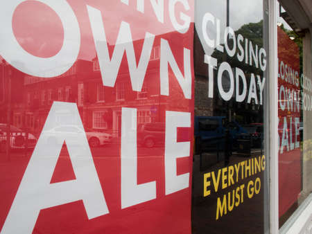 discounting: Closing today everything must go and sale posters in retail shop window
