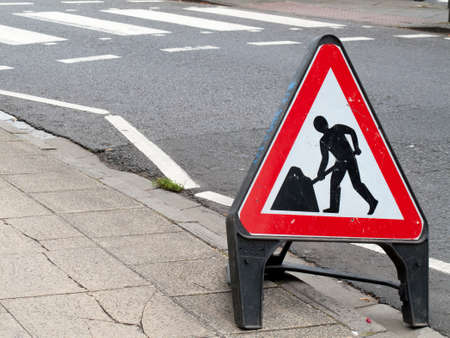winchester: Highway roadworks sign on approach to zebra crossing Editorial