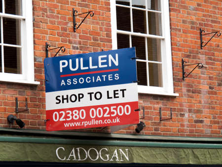 Pullen Associates shop to let advertising sign over vacant retail premises Editorial