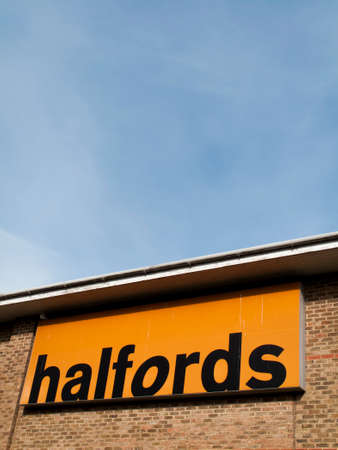 merchant: August 28, 2017: Halfords Group plc, British retailer of car parts, camping, touring equipment, bicycles MOT service and repairs Editorial