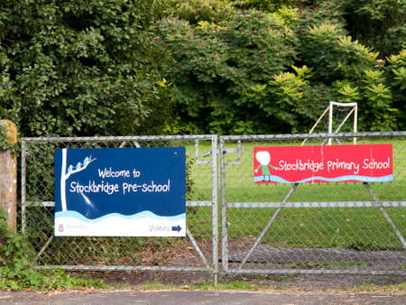 publicize: Welcome to Stockbridge pre school banner mounted on gate to playing field