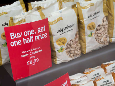 Holland and Barrett curly cashews window display, company formed in 1870 by Alfred Slapps Barrett and Major William Holland
