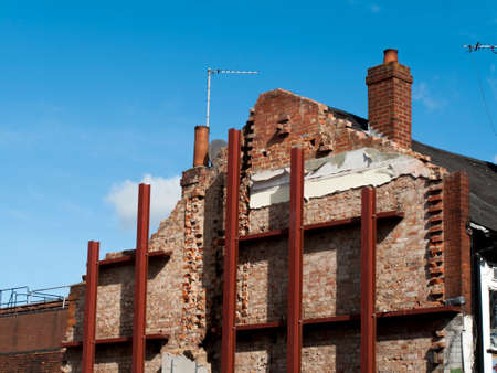 Building shored up with steelwork due to demolition and redevelopment of adjacent structure