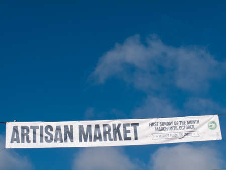 Artisan Market advertisement banner across street, organised by the city council, food, handmade arts and crafts, jewellery, home furnishing