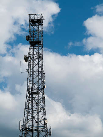 Mobile telephone communications base station tower sited on farmland