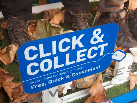 Click and collect sign in retail shop window, order online for free delivery in store