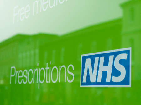 NHS, National Health Service prescriptions sign in pharmacy
