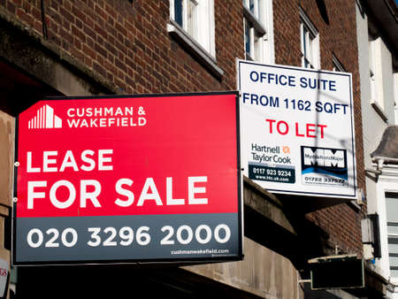 Estate agent advertising signs, retail unit lease for sale over vacant shop premises and offices to let