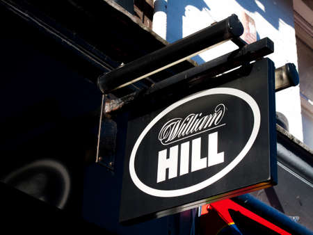 William Hill bookmakers sign, company founded by William Hill in 1934 at a time when gambling was illegal in Britain Редакционное