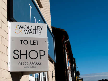 Shop to let sign over vacant retail premises