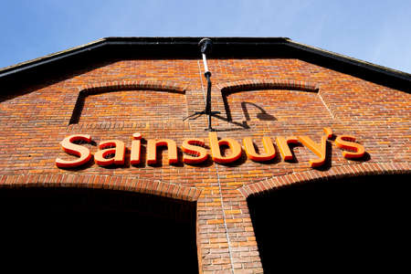 Sainsburys supermarket sign over entrance, founded in 1869 by John James Sainsbury with a shop in Drury Lane London