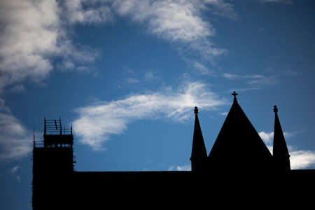 Silhouette of scaffolding to restoration work to Anglican medieval gothic Cathedral