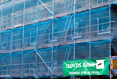 scaffolding with safety netting, renovation works being carried to Lloyds Bank building exterior Editöryel