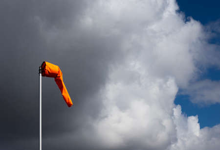 Airfield windsock, used to indicate wind speed and direction, shown deflated due to lack of wind