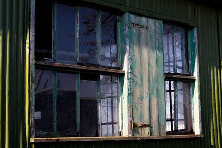 Dilapidated wooden window frame on condemned derelict factory building awaiting demolition Stock Photo