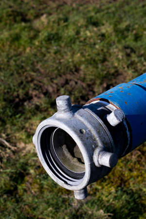 Six inch diameter pipe connection for hose to drain water tank Reklamní fotografie - 121437918