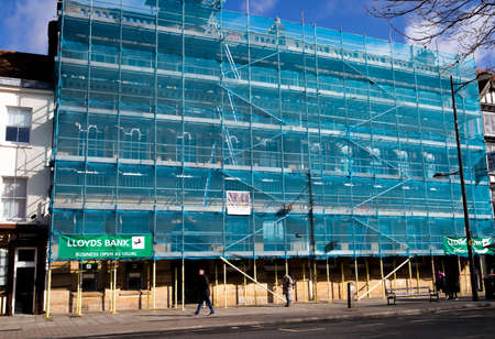 scaffolding with safety netting, renovation works being carried to Lloyds Bank building exterior Editorial