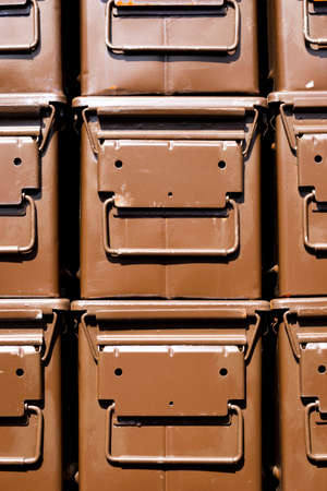 Stacked brown ammunition boxes designed for the safe transportation of bullets, shells and explosive items