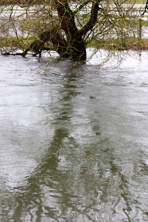 Flooded river after heavy storm rainfall flooding adjacent farmland