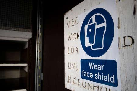 Mandatory construction health and safety wear face shield sign Reklamní fotografie