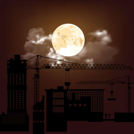 Silhouetted generic construction site at night against a stunning full moon and cloud sky