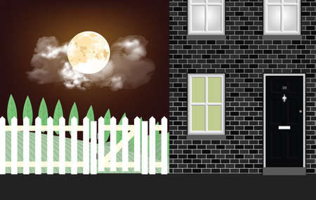Residential house at night time with stunning full moon and cloudy sky
