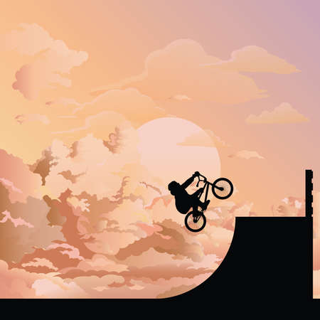 Silhouetted BMX rider performing stunts set against a dawn sky background