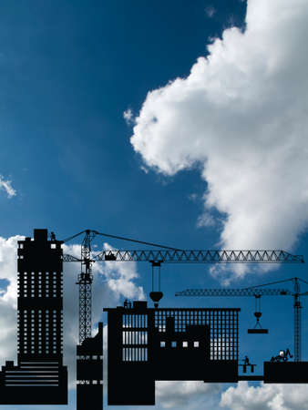 Silhouetted generic urban construction development set against a blue cloudy sky