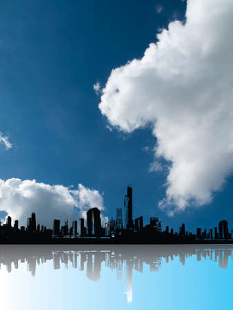 Silhouetted generic city skyline with foreground reflection and blue cloudy sky above