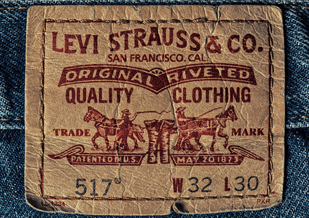 levi: LEVIS leather label on the blue jeans. LEVIS is a brand name of Levi Strauss and Co, founded in 1853