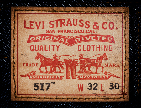 illustrative material: LEVIS leather label on the blue jeans. LEVIS is a brand name of Levi Strauss and Co, founded in 1853