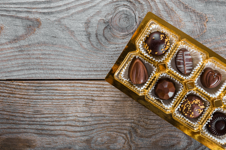 Assorted chocolate candies on a wooden background Archivio Fotografico
