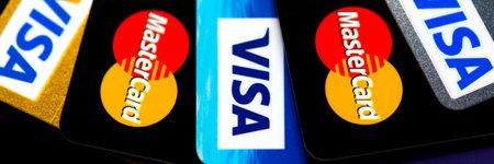 Plastic card VISA, Mastercard. Selective focus Редакционное