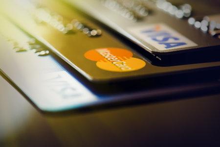 Plastic card VISA, Mastercard. Selective focus Editorial