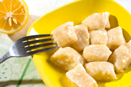 Boiled pieces of cheese dough on plate
