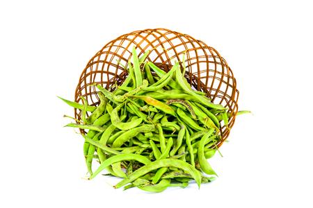 long bean: Green bean pods in wicker basket on white background Stock Photo